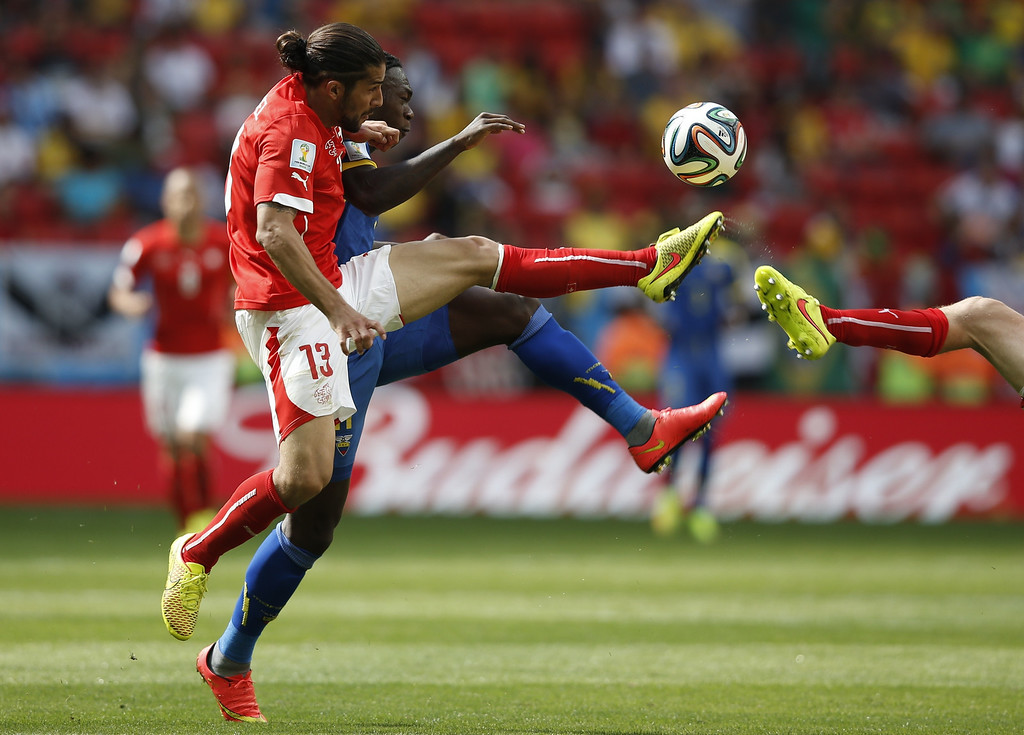 . xxxSwitzerland\'s defender Ricardo Rodriguez xx (L) and Ecuador\'s forward Felipe Caicedo vie for the ball during a Group E football match between Switzerland and Ecuador at the Mane Garrincha National Stadium in Brasilia during the 2014 FIFA World Cup on June 15, 2014. AFP PHOTO / ADRIAN DENNIS