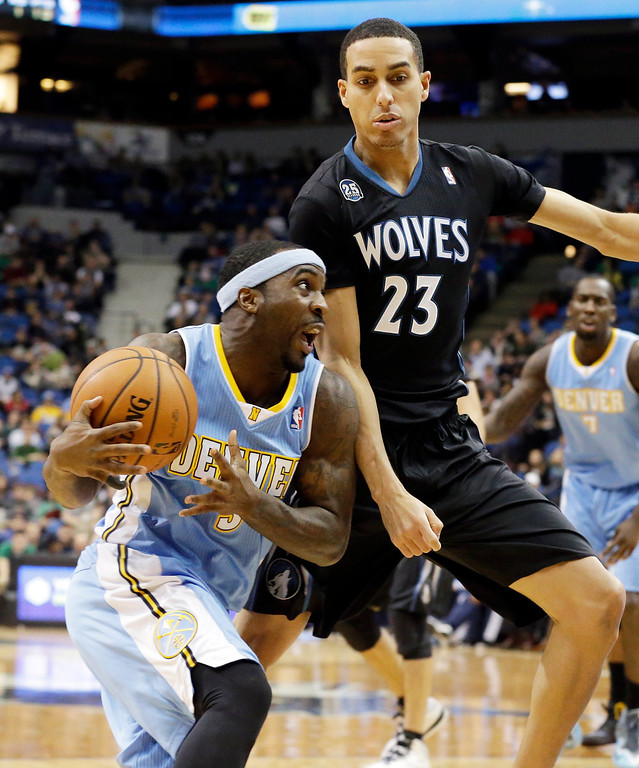 . Denver Nuggets\' Ty Lawson, left, drives around Minnesota Timberwolves\' Kevin Martin in the second half of an NBA basketball game on Wednesday, Nov. 27, 2013, in Minneapolis. Lawson led the Nuggets with 23 points while Martin led the Timberwolves with 29 points. The Nuggets won 117-110. (AP Photo/Jim Mone)
