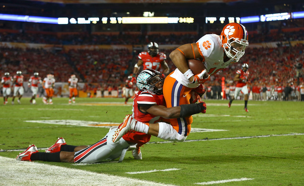 . MIAMI GARDENS, FL - JANUARY 03: Jordan Leggett #16 of the Clemson Tigers is tackled by Tyvis Powell #23 of the Ohio State Buckeyes in the second quarter during the Discover Orange Bowl at Sun Life Stadium on January 3, 2014 in Miami Gardens, Florida.  (Photo by Streeter Lecka/Getty Images)