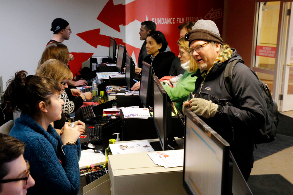 Description of . Festival goers talk with ticket agents inside the box office during the 2013 Sundance Film Festival on Thursday, Jan. 17, 2013 in Park City, Utah. (Photo by Danny Moloshok/Invision/AP)
