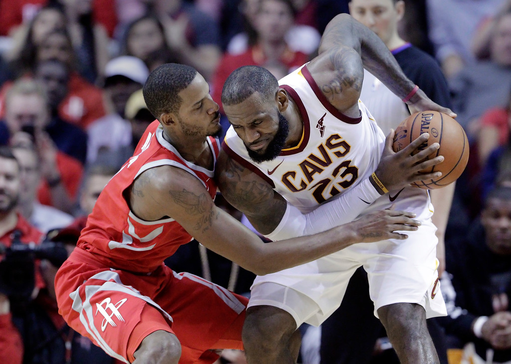 . Houston Rockets forward Trevor Ariza (1) tries to steal the ball from Cleveland Cavaliers forward LeBron James (23) during the second half of an NBA basketball game Thursday, Nov. 9, 2017, in Houston. (AP Photo/Michael Wyke)
