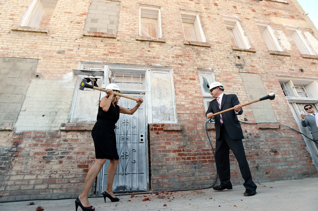 . Long Beach, Calif., -- 05-21-13-  Michelle and John Molina from real estate development team Millworks take a swing during the groundbreaking of the second phase of a project at the historic Meeker Baker Building on Monday, May 20th 2013. The 6th & Pine Development Project, managed by Long Beach based commercial real estate developer Millworks, encompasses a full city block located on Pine Avenue between 6th and 7th Streets that includes the former Press-Telegram and Meeker Baker buildings. Once both buildings are completed, the offices will house approximately 1,000 new Molina Healthcare employees in more than 200,000 square feet of office space and breathe new life into the North Pine neighborhood of the Downtown.    Stephen Carr/  Los Angeles Newspaper Group