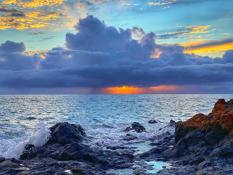 Dramatic Sunset in Maui on the shore in Kehei.