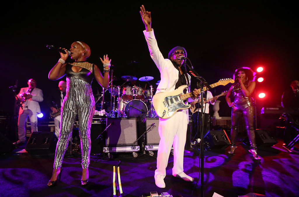. Recording artists Kimberly Davis (L) and Nile Rodgers perform onstage during the Warner Music Group annual GRAMMY celebration at Sunset Tower on January 26, 2014 in West Hollywood, California.  (Photo by Christopher Polk/Getty Images for Warner Bros.)
