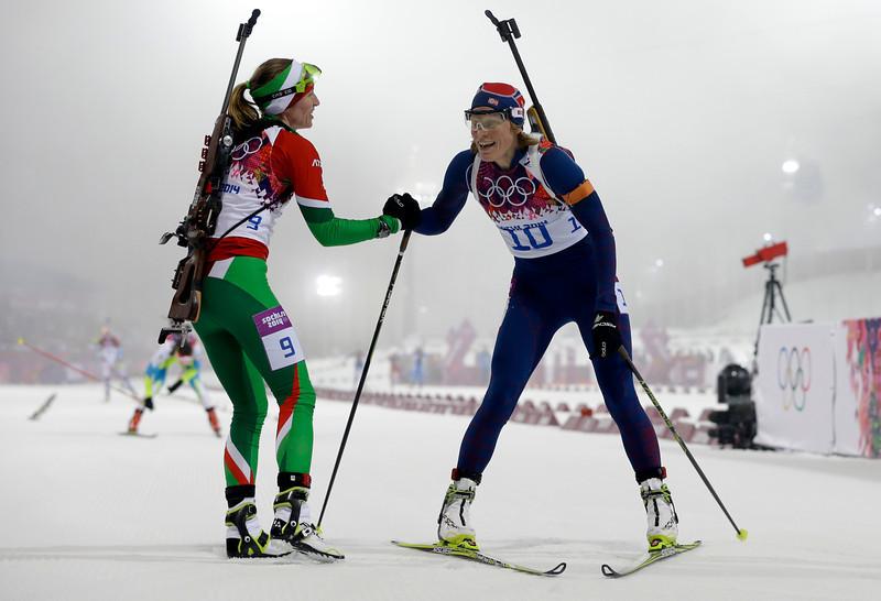 . Belarus\' Darya Domracheva, left, congratulates silver medalist Norway\'s Tora Berger, after winning the gold in the women\'s biathlon 10k pursuit, at the 2014 Winter Olympics, Tuesday, Feb. 11, 2014, in Krasnaya Polyana, Russia. (AP Photo/Kirsty Wigglesworth)