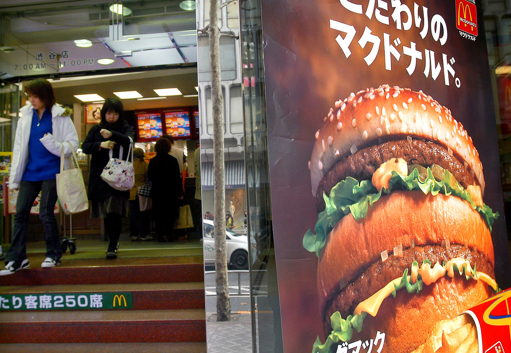 . A Big Mac poster is displayed outside a McDonald\'s outlet in Tokyo Friday, Feb. 13, 2004. (AP Photo/Katsumi Kasahara)