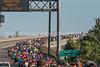Runners leave U.S.S. North Carolina Battleship Memorial and make the climb up S Thomas Rhodes Bridge to downtown Wilmington during Battleship North Carolina half-marathon Sunday November 6, 2016 in Wilmington, N.C.  Alan Morris/Star News