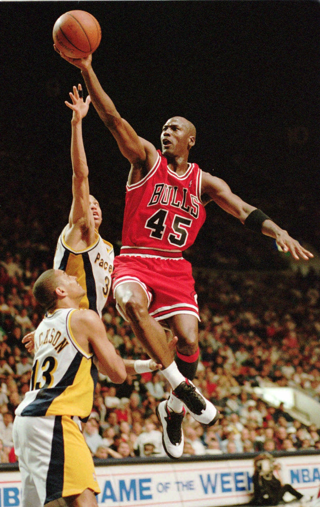 Description of . Chicago Bulls'  Michael Jordan flies to the hoop over the Indiana Pacers' Reggie Miller and Mark Jackson (13), in Indiana in this March 19, 1995 photo.  Jordan,  the greatest player in NBA history and the most popular athlete since Muhammad Ali is expected to announce his retirement Wednesday  at a news conference in Chicago, a source with close ties to the NBA told The Associated Press on Monday night Jan. 11, 1999. (AP Photo/Michael Conroy)