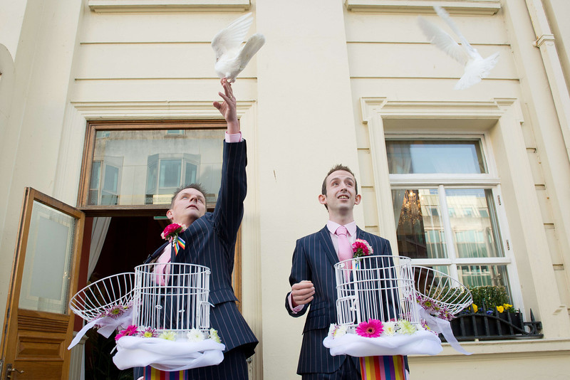 ". Phil Robathan (L) and James Preston (R) release doves following their wedding ceremony in Brighton, southern England, on March 29, 2014. Gay couples across England and Wales said ""I do\"" as a law legalizing same-sex marriage came into effect at midnight, the final stage in a long fight for equality.  (LEON NEAL/AFP/Getty Images)"