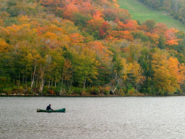 Canoeing on a Mountain Lake in Autumn