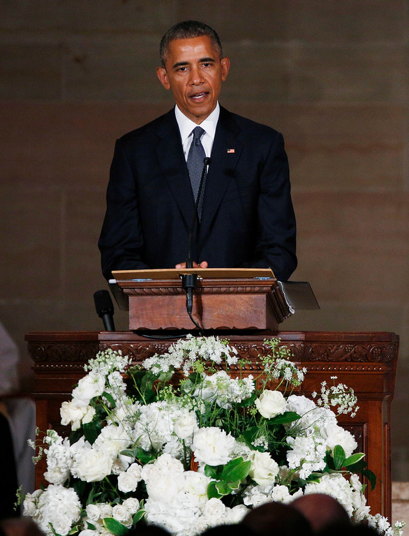 . President Barack Obama delivers the eulogy in honor of former Delaware Attorney General Beau Biden, Saturday, June 6, 2015, at St. Anthony of Padua Church in Wilmington, Del. Biden, Vice President Joe Biden\'s eldest son, died at the age of 46 after a battle with brain cancer. (Kevin Lamarque/Pool Photo via AP)