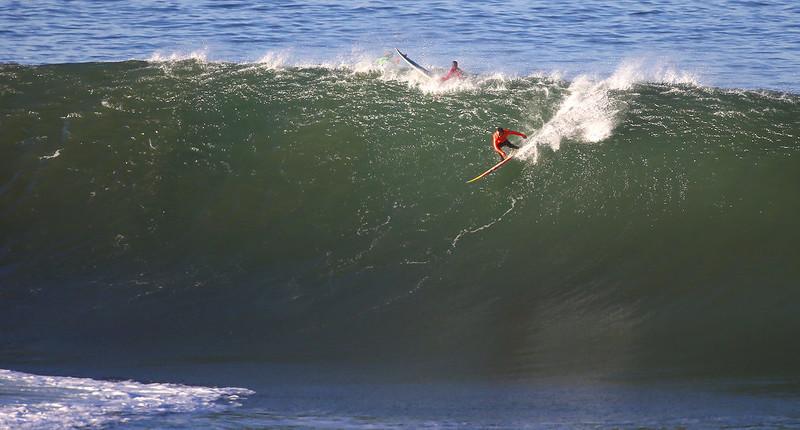 . Surfer Tyler Fox takes off on a wave during the first heat of the Mavericks Invitational on Sunday, Jan. 20, 2013 near Half Moon Bay, Calif.  (Aric Crabb/Staff)