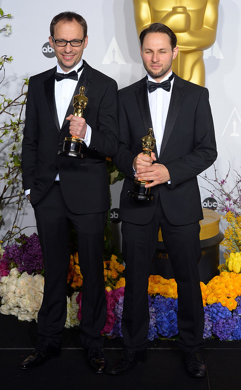 ". Laurent Witz and Alexandre Espigares who won the Oscar for ""Best Animated Short Film\"", backstage at the 86th Academy Awards at the Dolby Theatre in Hollywood, California on Sunday March 2, 2014 (Photo by David Crane / Los Angeles Daily News)"