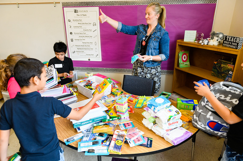 Third and fourth-grade teacher Brittany Inman helps students organize their classroom materials. Back to school day at Hallman Elementary School on Wednesday, September 4, 2019 in Salem, Ore.
