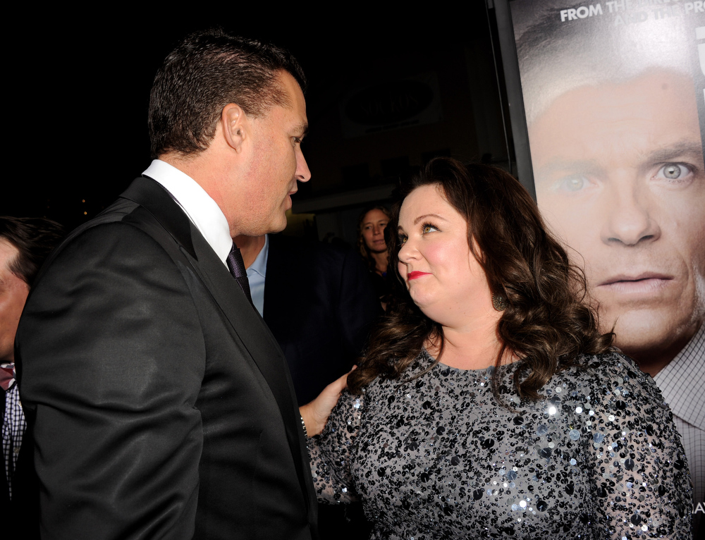 Description of . Producer Scott Stuber (L) and actress Melissa McCarthy arrive at the premiere of Universal Pictures'