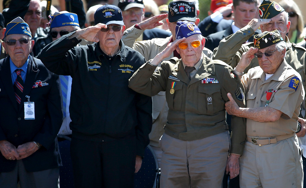 """. WWII Veterans salute during the playing of \""""Taps\"""" at a ceremony with U.S. President Barack Obama at the Normandy American Cemetery on the 70th anniversary of D-Day June 6, 2014 in Colleville-sur-Mer, France.   (Photo by Win McNamee/Getty Images)"""