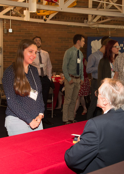 """Kayla Bigham with John Mather, as he signs copies of his book """"The Very First Light"""" -- An award luncheon, """"Dr. John Mather Nobel Scholars Program Award"""", as part of the National Space Grant Foundation. College Park Aviation Museum, College Park, MD, August 2, 2019."""