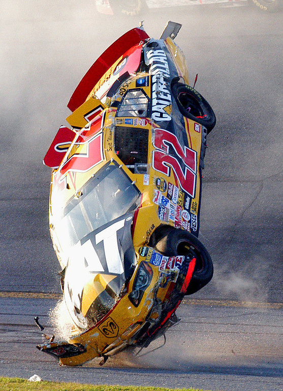 . The car of NASCAR driver Scott Wimmer (22) flips through the air during a multi-car wreck in Turn 3 and 4 during the Daytona 500 at the Daytona International Speedway in Daytona Beach, Fla., on Sunday, Feb. 20, 2005. (AP Photo/Rob Sweeten)