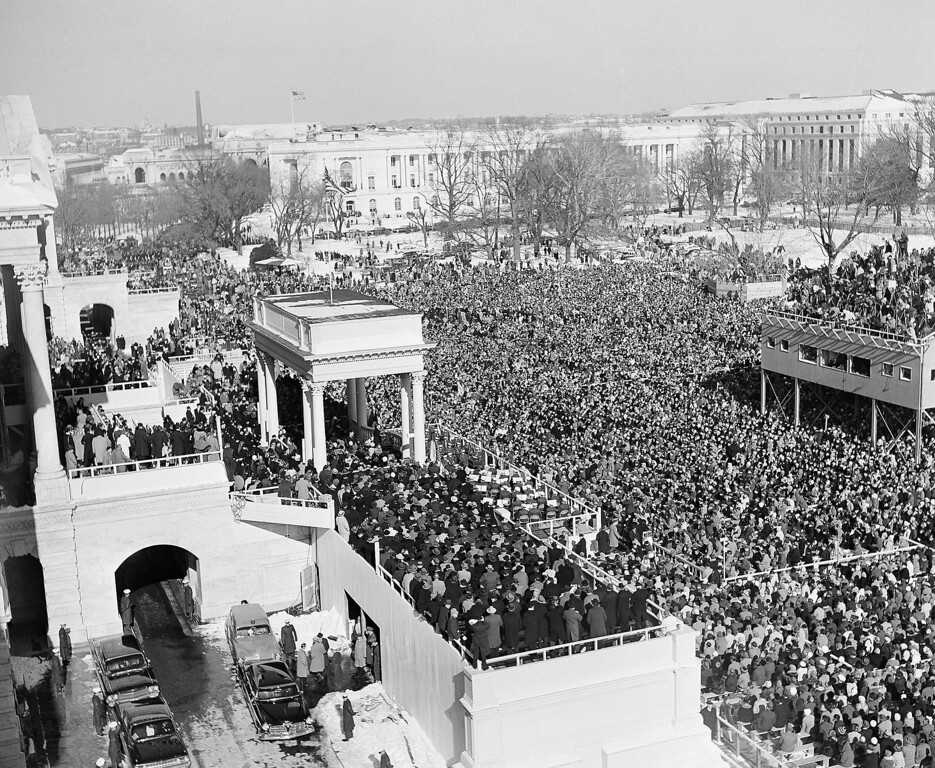 . In this Jan. 20, 1961 black-and-white file photo, the crowd in Capitol Plaza gather to witness the inauguration of John F. Kennedy as President of the United States. (AP Photo)