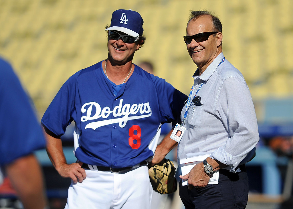 . Los Angeles Dodgers manager Don Mattingly shares a smile with Joe Torre during batting practice August 12, 2013.  The Dodgers are in town hosting the Mets for a three game series.(Andy Holzman/Los Angeles Daily News)