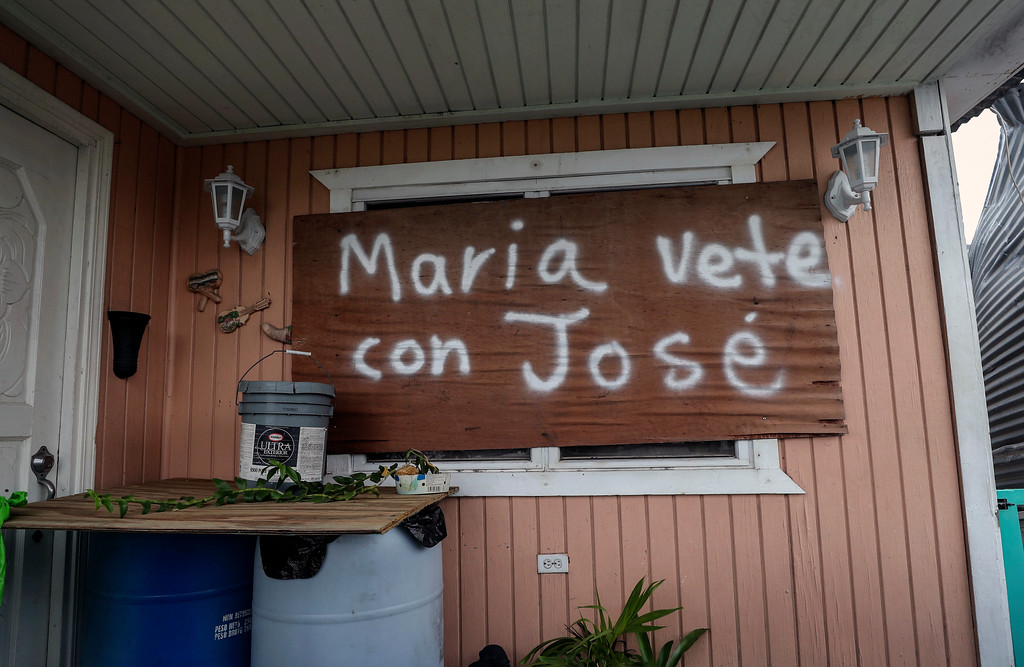 ". The boarded up home of Ricardo Velazquez Mercado carries the Spanish message: ""Mary go away with Jose\"" in the Punta Diamante area of Ponce, Puerto Rico, Thursday, Sept. 21, 2017. A humanitarian crisis grew Saturday in Puerto Rico as towns were left without fresh water, fuel, power or phone service following Hurricane Maria�s devastating passage across the island. (AP Photo/Jorge A Ramirez Portela)"