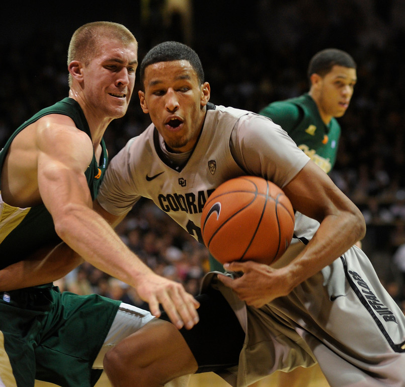 . Rams forward Pierce Hornung, left, reached for the ball as Buffs guard Andre Roberson, right, drove to the basket in the first half. The University of Colorado men\'s basketball team hosted Colorado State University inside the Coors Events Center Wednesday night, November 5, 2012. Karl Gehring/The Denver Post