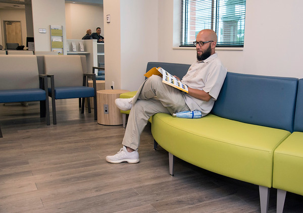 06/10/19 Wesley Bunnell | Staff Volunteer William BJ Evans looks over some of the brochures at the Bristol Health Medical Care Center which opened for patients on Monday