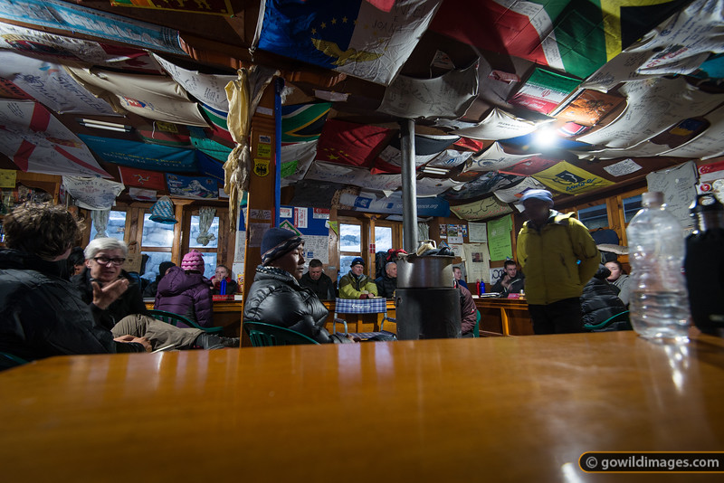Flags from trekking groups adorn the ceiling of Buddha lodge, Gorak Shep. Staying here is not recommended for individual trekkers, as tables are booked out for organised groups. R500 per hour to charge batteries.