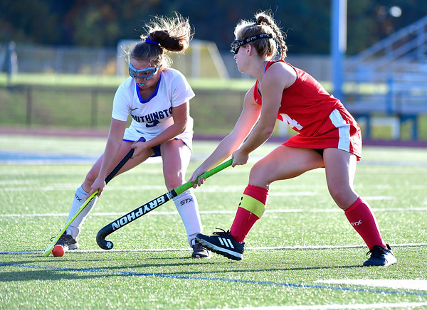 10/15/2019 Mike Orazzi | StaffrSouthington's Nicole Greco r(9) and Conard High Schools Libby Geisler (4) during a 2-2 tie in field hockey action in Southington on Tuesday afternoon.