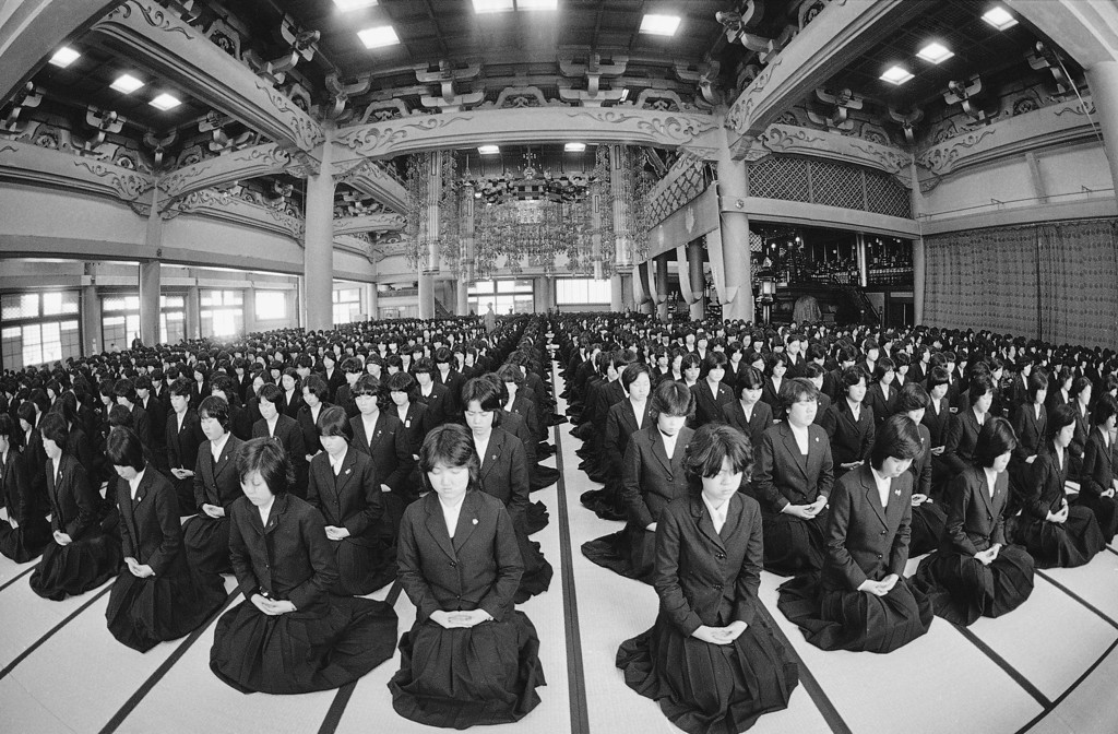 . Some 2,500 high school students in school uniforms practice Zen meditation on tatami, or straw mates in Sojiji Temple Zen Hall in Yokohama, Japan on Tuesday, Jan. 23, 1979, before their classes start. This unusual practice for most Japanese became an annual event since 1966 for the students of Tsurumi Women�s Junior and Senior High School of Yokohama, which was founded by a Zen Buddhist. (AP Photo/Katsumi kasahara)