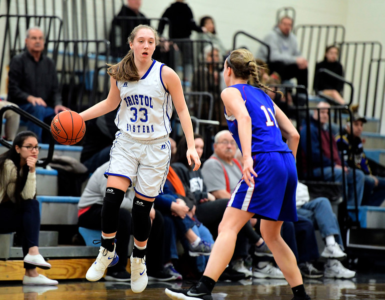 2/9/2019 Mike Orazzi | Staff Bristol Eastern's Jordan Ouellette (33)  and Rocky Hill's Nikki Lukens (11) during Saturday's girls basketball game in Bristol.