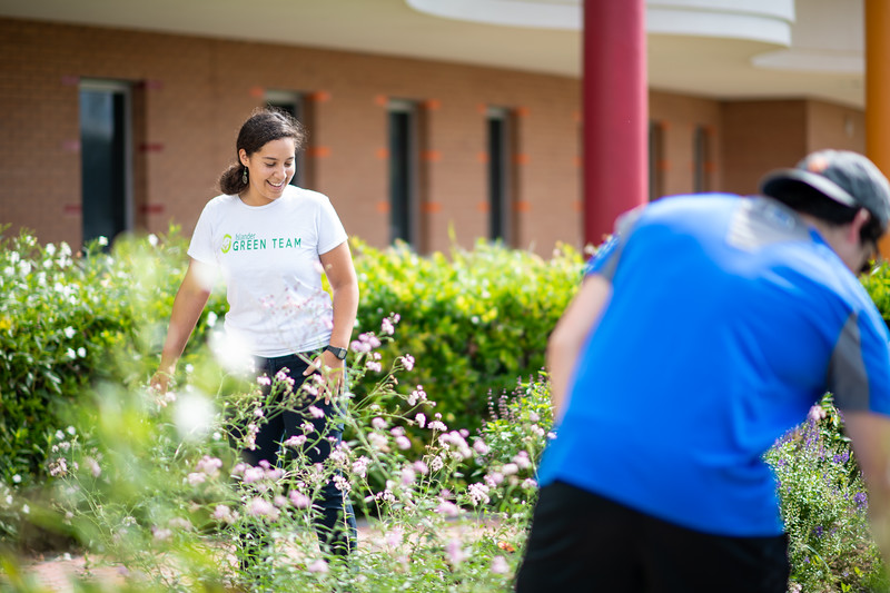 Melissa Zamora (left), and Joel Dominguez work on the Early Childhood and Development Center's community garden.