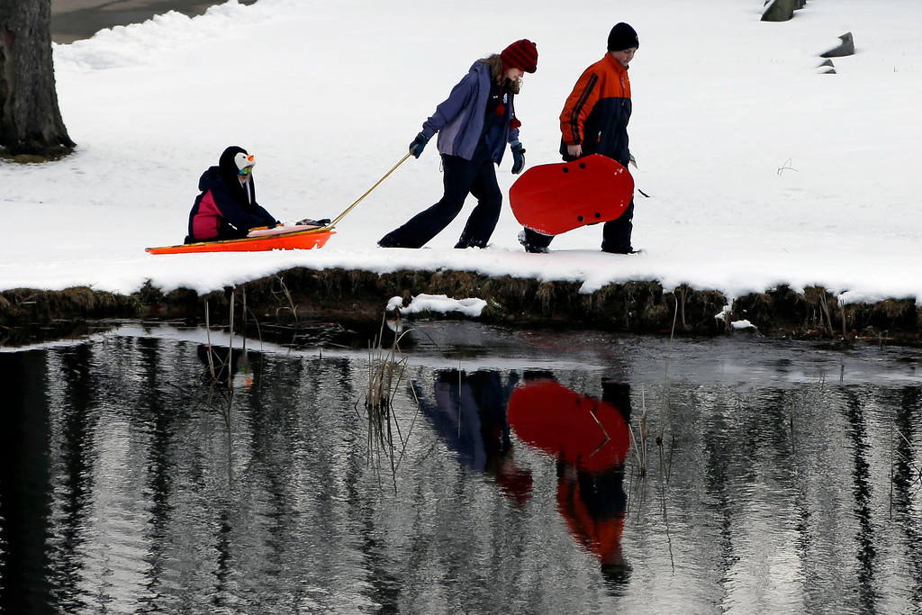 . Sledding in the Homewood Cemetery was a way to spend a snow-day off school for Pittsburgh city school students,  Wednesday, March 6, 2013. By afternoon the 3-5 inches that fell in Pittsburgh was melting as temperatures neared 40 degrees. (AP Photo/Gene J. Puskar)