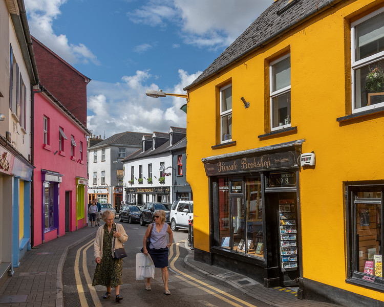Shoppers walking past stores on the street, Kinsale, County Cork, Ireland