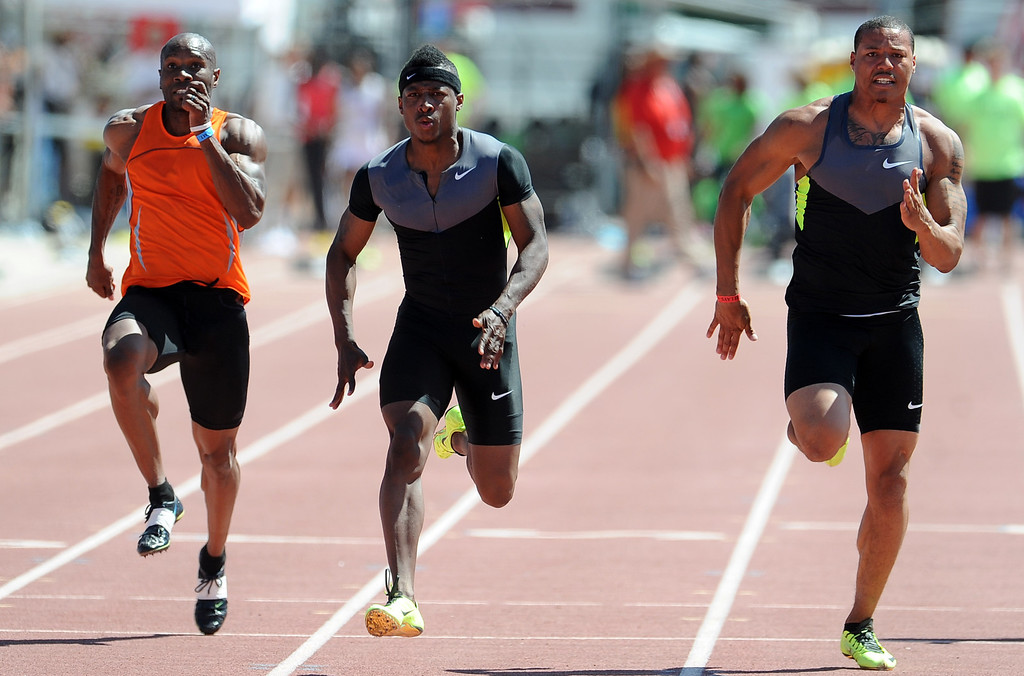 . Mike Rodgers, center, of Nike wins the 100 meter dash invitational elite during the Mt. SAC Relays in Hilmer Lodge Stadium on the campus of Mt. San Antonio College on Saturday, April 20, 2012 in Walnut, Calif.    (Keith Birmingham/Pasadena Star-News)
