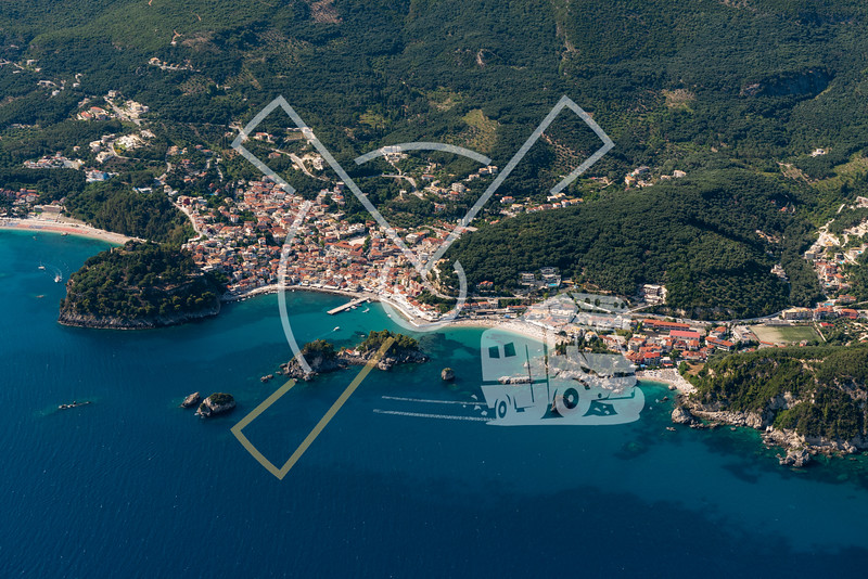 Aerial image showing the town of Parga with its beaches, the castle, marina in Greece