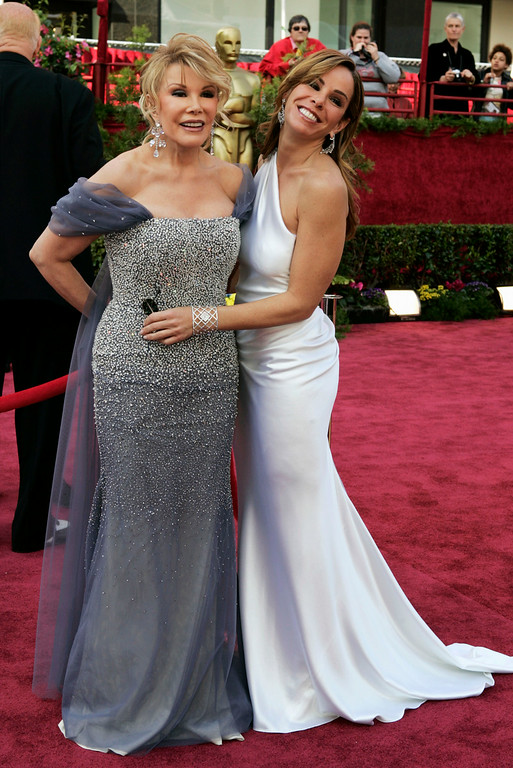 . Joan Rivers, left, and daughter, Melissa, from the TV Guide Channel are seen on the red carpet for Oscar arrivals before the 77th annual Academy Awards Sunday, Feb. 27, 2005, in Los Angeles. (AP Photo/Amy Sancetta)