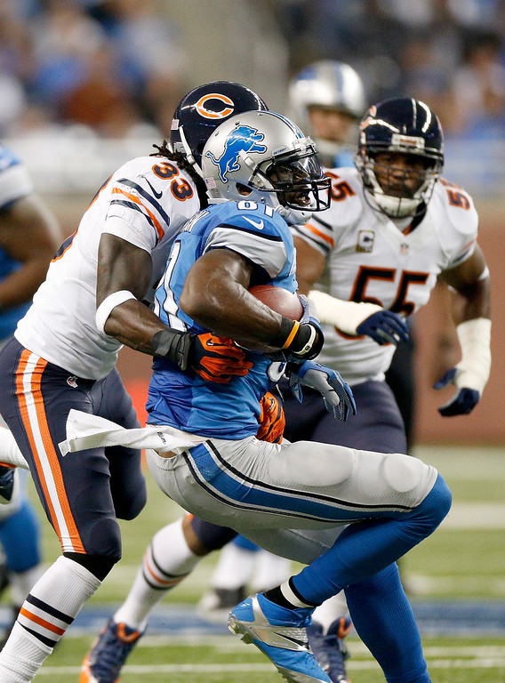 . DETROIT, MI - SEPTEMBER 29:  Charles Tillman #33 of the Chicago Bears brings down Calvin Johnson #81 of the Detroit Lions at Ford Field on September 29, 2013 in Detroit, Michigan. (Photo by Gregory Shamus/Getty Images)