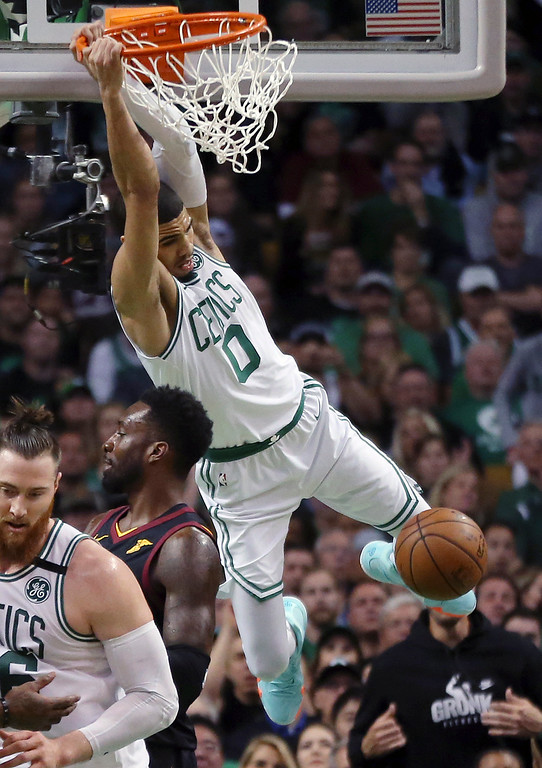 . Boston Celtics forward Jayson Tatum (0) dunks over Cleveland Cavaliers forward Jeff Green during the first half in Game 7 of the NBA basketball Eastern Conference finals Sunday, May 27, 2018, in Boston. (AP Photo/Elise Amendola)