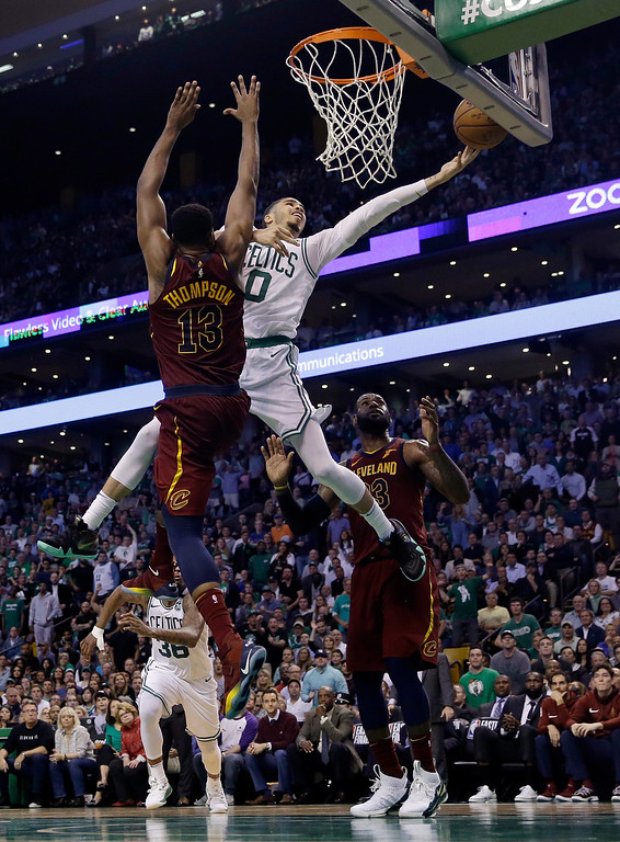 . Boston Celtics forward Jayson Tatum (0) drives to the basket against Cleveland Cavaliers center Tristan Thompson (13) during the second half in Game 2 of the NBA basketball Eastern Conference finals Tuesday, May 15, 2018, in Boston. (AP Photo/Charles Krupa)