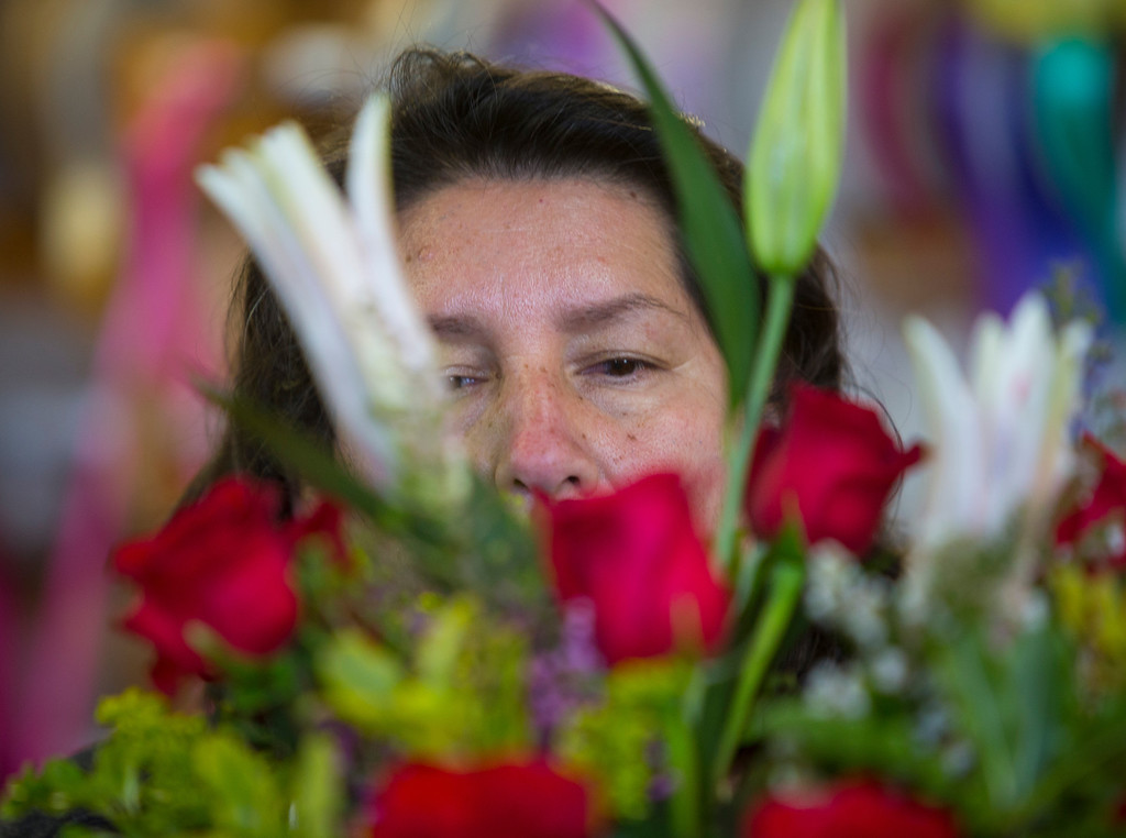 . With an eye for detail Valvena Rodriguez makes a bouquet at Repetto\'s Greenhouse Florist and  in Half Moon Bay, Calif. on Wednesday, Feb. 13, 2013. Repetto\'s expects to be busy on Valentine\'s Day. (John Green/Staff)