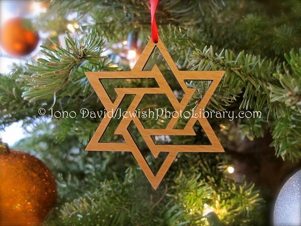 USA, California, San Francisco. Hanukkah ornaments on a mixed holiday tree (Mystic Hotel lobby) (12.2012)