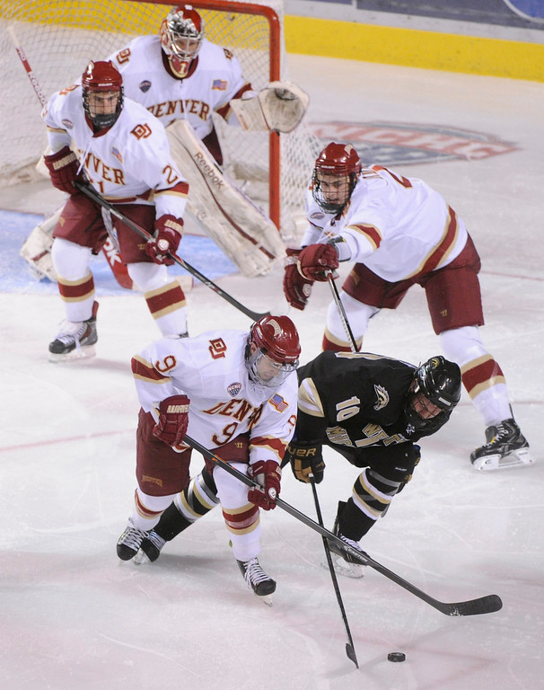 . DENVER, CO. - NOVEMBER 16: Denver center Gabe Levin (9) tried to take the puck from Western Michigan center Josh Pitt (10) in the final period. The University of Denver hockey team defeated Western Michigan 1-0 at Magness Arena Saturday night, November 16, 2013.  Photo By Karl Gehring/The Denver Post