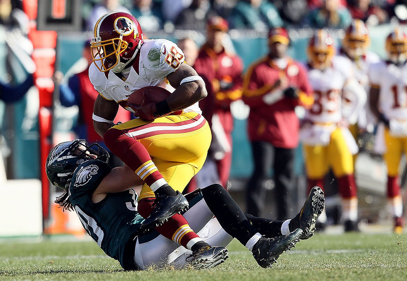 . Colt Anderson #30 of the Philadelphia Eagles tackles Pierre Garcon #88 of the Washington Redskins during the first quarter of their game at Lincoln Financial Field on December 23, 2012 in Philadelphia, Pennsylvania.  (Photo by Alex Trautwig/Getty Images)