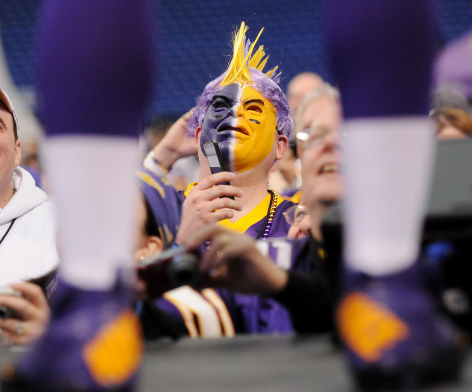 . A Vikings fan listens as quarterback Christian Ponder answers questions during the Vikings Draft Party at the Metrodome. (Pioneer Press: John Autey)