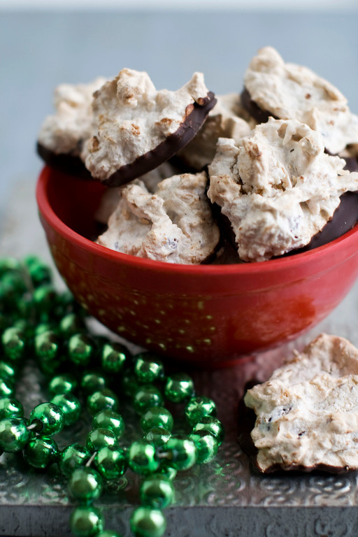 ". <a href=""http://www.denverpost.com/2012/11/19/recipe-chocolate-dipped-coconut-meringue-drops/\"">Get the recipe for chocolate-dipped coconut meringue drops</a>. (AP Photo/Matthew Mead)"