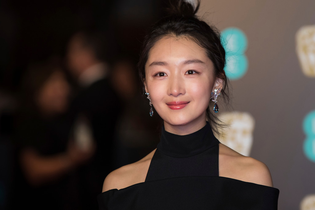 . Zou Dongyu poses for photographers upon arrival at the BAFTA Awards 2018 in London, Sunday, Feb. 18, 2018. (Photo by Vianney Le Caer/Invision/AP)