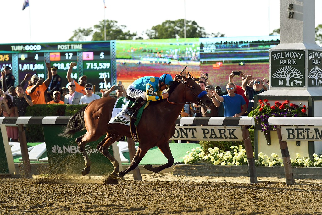 . American Pharoah ridden by Victor Espinoza crosses the finish line to win the 147th Belmont Stakes at Belmont Park on June 6, 2015 in Elmont, New York. American Pharoah ended US racing\'s 37-year Triple Crown drought on Saturday with a convincing victory in the Belmont Stakes.  AFP PHOTO / TIMOTHY A.  CLARY/AFP/Getty Images
