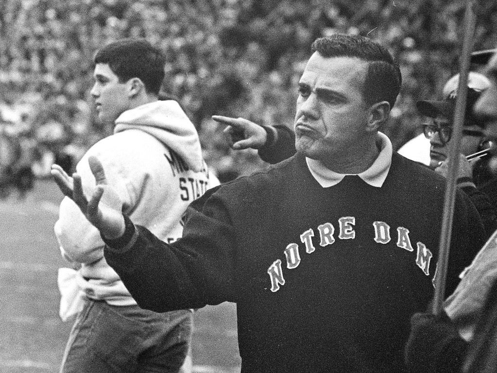 . FILE - In this Nov. 19, 1966, file photo, Notre Dame coach Ara Parseghian gestures during a college football game against Michigan State, in East Lansing, Mich. Parseghian, who took over a foundering Notre Dame football program and restored it to glory with two national championships in 11 seasons, died Wednesday, Aug. 2, 2017, at his home in Granger, Ind. He was 94. (AP Photo/File)