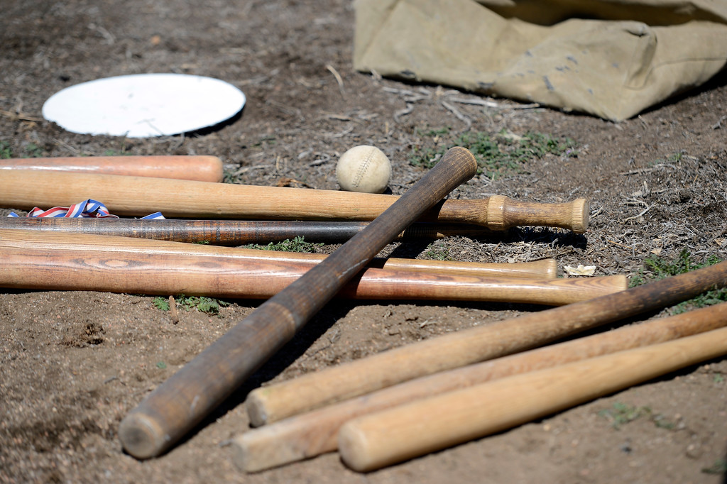 . DENVER, CO. - APRIL 14: Old time baseball bats and ball littered the backstop during a vintage game with the Central City Stars taking on the Denver Blue Stockings April 14, 2013 at  Riverside Cemetery in Denver. (Photo By John Leyba/The Denver Post)